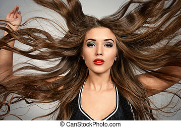 healthy hair - Portrait of a beautiful young woman with long...