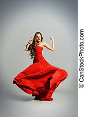 motion of dress - Beautiful sexual woman in red evening...