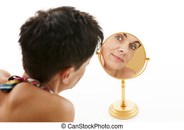 woman in the mirror on white - Face of a middle-aged woman...