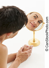 woman in the mirror on white_vertical - Face of a...