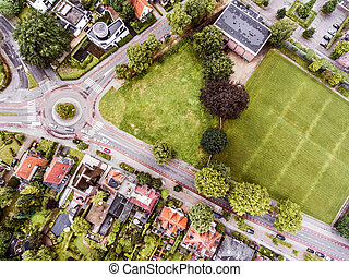 Aerial view of Dutch town, builidings, park, roundabout -...