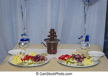 Chocolate fountain in banquet - Chocolate fountain on table...