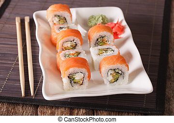 Philadelphia sushi roll with salmon served with wasabi and...