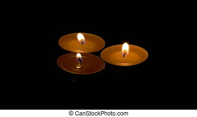 Candles floating on water - A set of three candles floating...