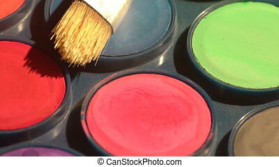 Watercolor paints and a brush - Setting of a watercolors box...