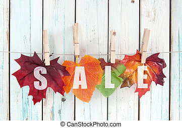 Autumn sale - Sales autumn leaves hanging on a line with...