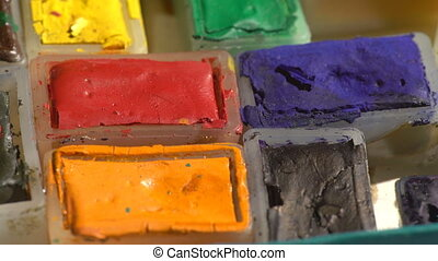Old used watercolor paints - Colorful view of an old...