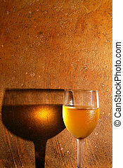 chilled glass of white wine against textured background
