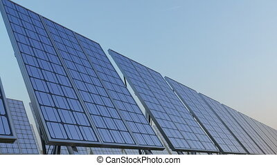 Row of modern solar panels against blue sky. Renewable solar energy generation. 4K seamless loopable clip. ProRes