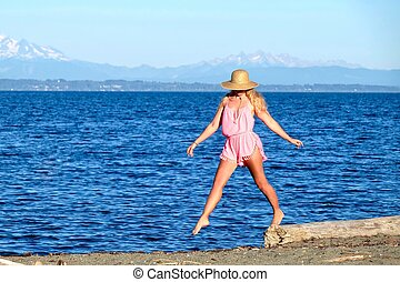 Young woman on beach by sea - Centennial Beach at Boundary...