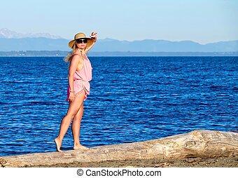 Woman on beach by ocean. - Centennial Beach at Boundary Bay...