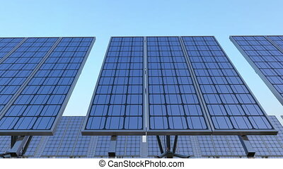 Line of solar panels against blue sky, looping dolly shot. Renewable solar energy production. 4K clip. ProRes