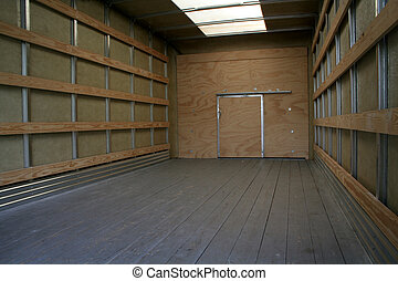 Moving Truck Interior - The empty interior of the back of a...