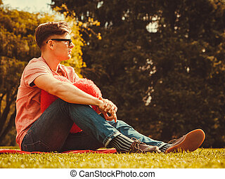 Young man resting in park - Love romance sadness heartbreak...