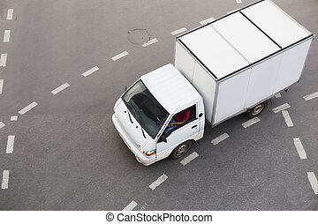 truck driving on city street
