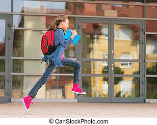 Girl back to school - Happy girl with book and backpack on...
