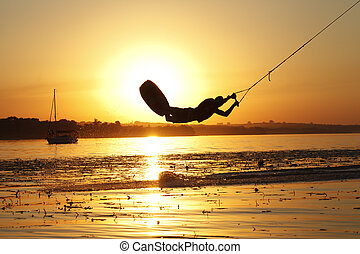 wakeboard, athlete silhouette on sunset background - a...
