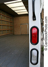 Moving Truck Rear - The empty interior of the back of a...