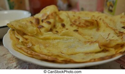 fried pancakes delicious on a plate slow motion video -...