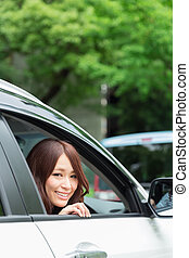woman in a car - Beautiful young asian woman in a car
