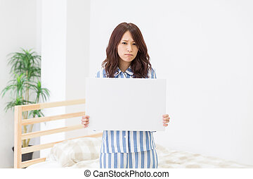 Woman having a white board - young attractive asian woman...