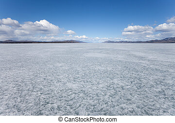 Frozen Lake Laberge, Yukon T., Cana - Vast ice surface of...