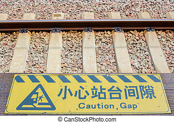 Railtrack closeup with Chinese warning sign - Rail track...