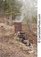 Home-made smoker for preservation of fish and meat by...