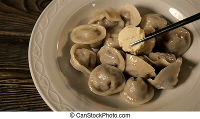 Cheif Puts Some Butter In Dumplings In The White Bowl, Slow...