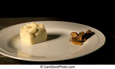 Chef Serves Beef Stroganoff With Mashed Potatoes On a Plate....