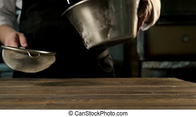 Chief's Hands Sifting Flour Through a Sieve For Baking, Slow...