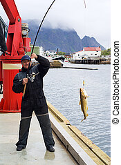 Fisherman on the pier on Lofoten island