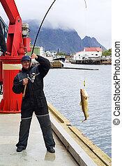 Fisherman on the pier on Lofoten island