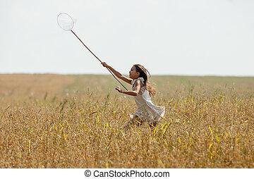 girl running on the field - Girl in white running on the...