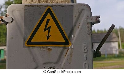 danger sign electricity transformer slow motion video -...