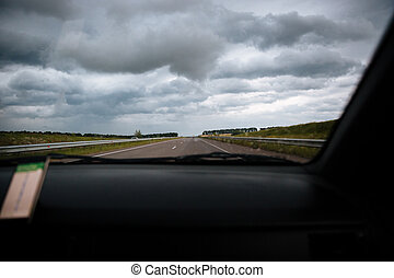 View from windshield of car driving on the road