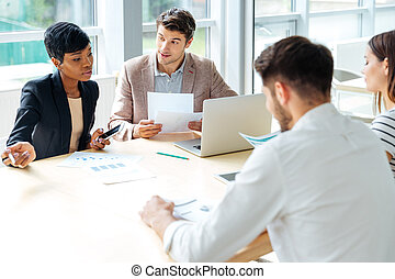 Businesspeople working together on business meeting in...