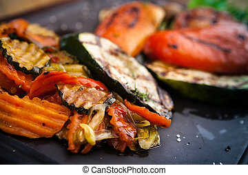 Grilled vegetables, baked in coal oven served on a warm...