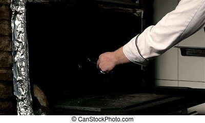 Chef Putting a Tray of a Juicy Steak In a Professional Oven,...