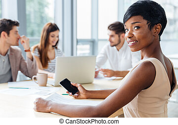 Businesswoman using blank screen smartphone on business...