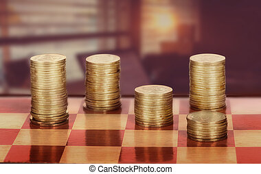 Coins on chessboard on the background of office space