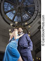 Tango Dancers Standing Below Cupola In Restaurant - Low...