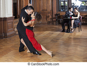 Tango Dancers Performing While Mid Adult Couple Dating -...