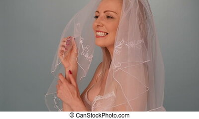 Bride wearing bra and veil - Beautiful sexy lady bride in...