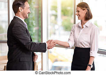 Positive colleagues shaking hands - Deal Positive colleagues...