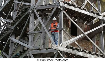 Construction worker shows thumb up and take pictures on...