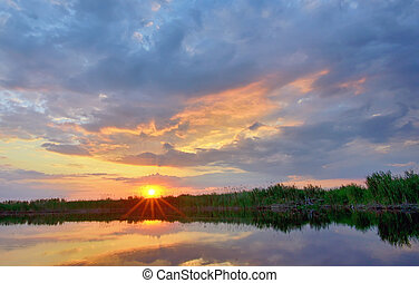 sunset over danube delta - Sunset over danube delta in...