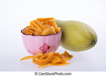 mango dry in bowl or dried mango slices. - mango dry in bowl...