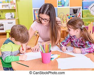 Creative Activities at Kindergarten - Teacher With Two...