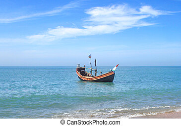 Fishing boat - Traditional fishing boat at the shore of the...